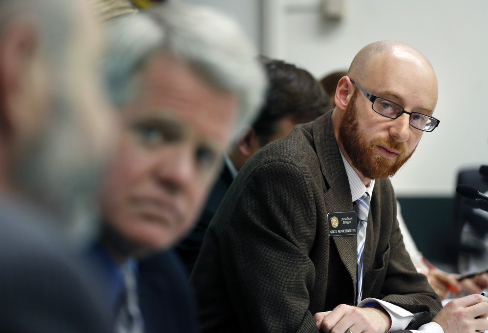 Rep. Jonathan Singer, D-Longmont, listens to discussion on a bill he sponsored which would allow marijuana dispensaries to form financial co-operatives, at the Colorado Legislature, in Denver on Wednesday.