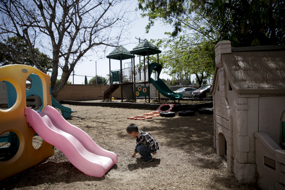In this April 14 photo, a 3-year-old boy plays on the playground at Community Day Preschool in Garden Grove, Calif. According to the school's executive director Sue Puisis, enrollment has dropped by more than 50 percent since 2008.