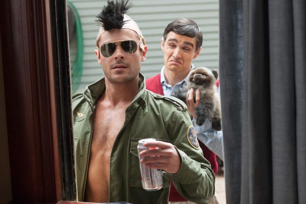 The comedy also stars Zac Efron, left, and Dave Franco as frat boys next door.