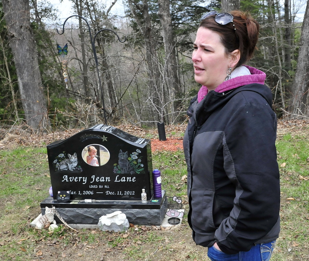 Tabitha Souzer, Avery Lane's mother, speaks at her daughter's gravesite at the Friend's Cemetery in Fairfield on Tuesday. Souzer said the gravesite has been vandalized three times, most recently over the weekend.