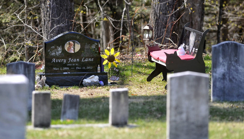 Decorations at the grave site of 6-year-old Avery Lane, shown Thursday, have been restored since the site was vandalized recently.