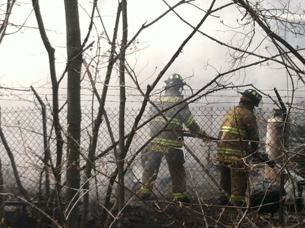 Firefighters engulfed by smoke work to extinguish a fire in Old Orchard Beach last week.