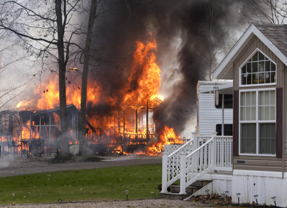OLD ORCHARD BEACH, ME - MAY 8: A fire reportedly started by sparks from a passing train, blazes at Wagon Wheel RV Resort and Campground in Old Orchard Beach on Thursday May 8, 2014. (Photo by Carl D. Walsh/Staff Photographer)