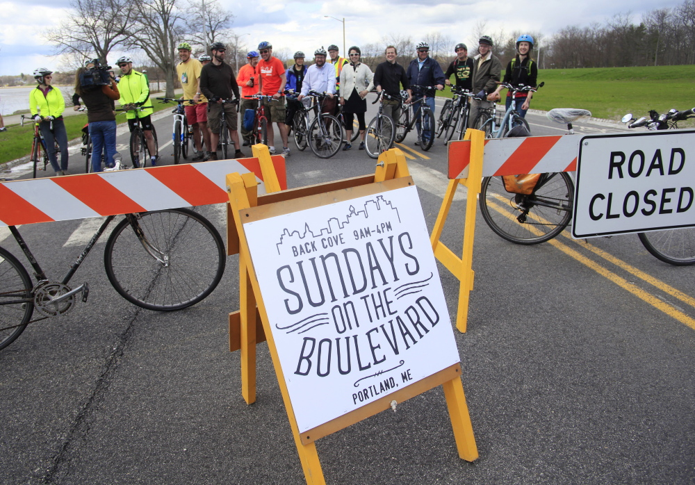 City officials and members of the Portland Bicycle and Pedestrian Advisory Committee gather May 4 to kick off the first of the Sunday closures of Baxter Boulevard to vehicular traffic. A section of the boulevard will be motor vehicle-free from 9 a.m. to 4 p.m. Sundays through Nov. 9.