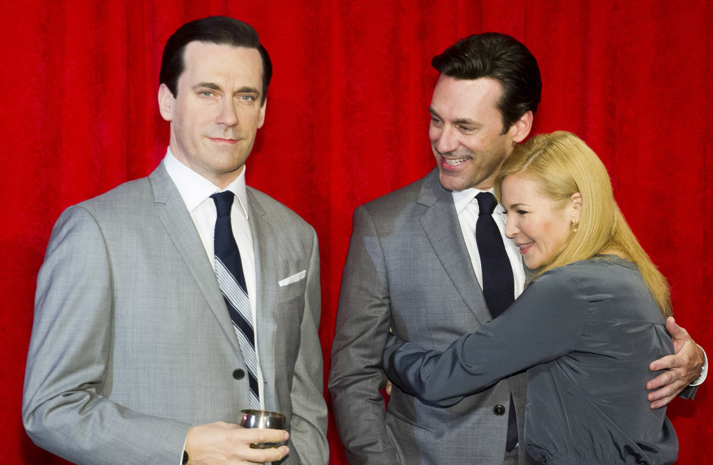 Jon Hamm and his girlfriend, Jennifer Westfeldt, embrace at the unveiling of his wax figure Friday in New York.