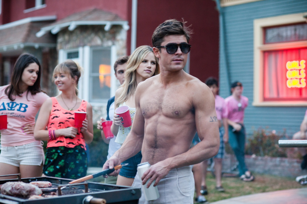 Zac Efron is one of the partying frat boys next door.