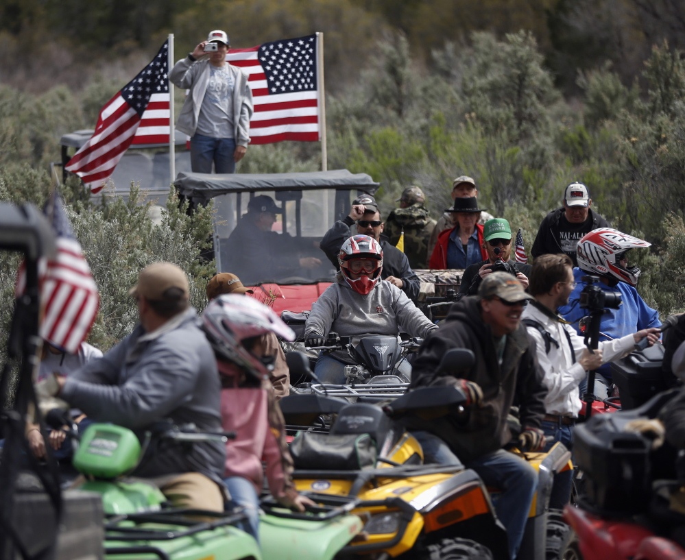 ATV riders arrive in Recapture Canyon outside Blanding, Utah, on Saturday to directly challenge federal control of protected lands in the American West.