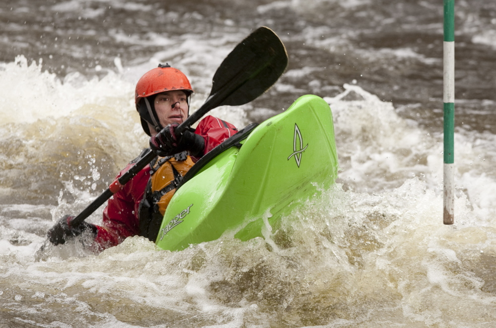 Belmont's Scott Nelson makes a splash on Kenduskeag Stream's whitewater slalom course, and the Maine Canoe and Kayak Racing Organization welcomes youngsters to do the same at its clinics.