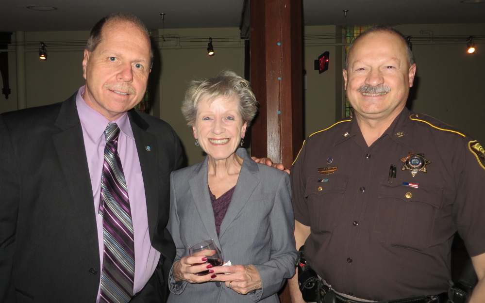Cumberland County Sheriff Kevin Joyce of Standish, Judith Reidman of Westbrook and Cumberland County Chief Deputy Naldo Gagnon of Raymond at the Family Crisis Services benefit.