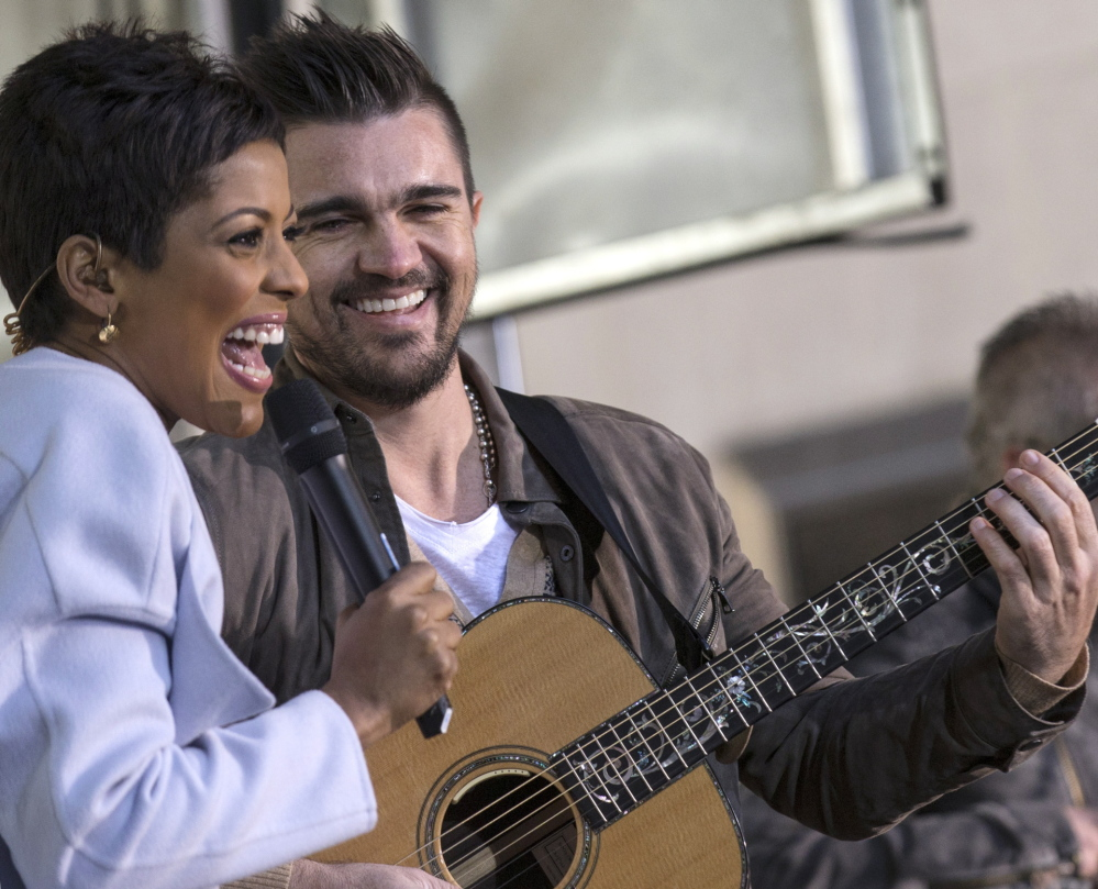 "Co-anchor Tamron Hall on the ""Today"" set with the Colombian singer Juanes."