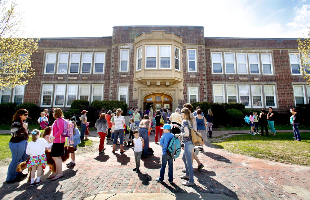 Students gather in front of Longfellow Elementary School in Portland at the end of a school day last May.