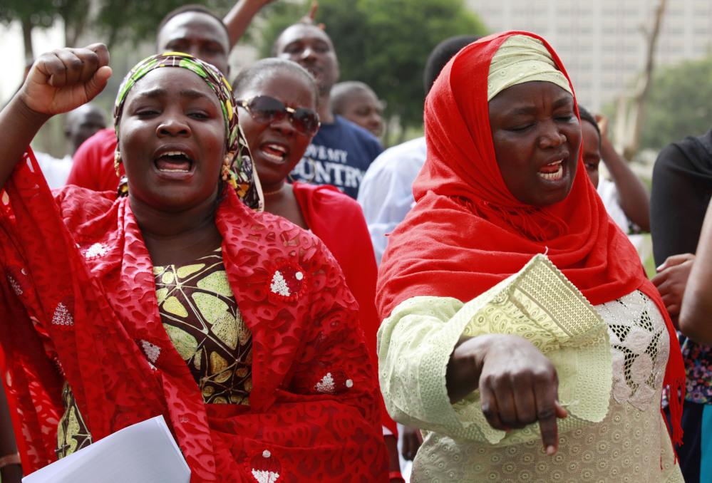 Women shout slogans during a rally Sunday calling on the Nigerian government to rescue the schoolgirls kidnapped from their school in Abuja, Nigeria. Secretary of State John Kerry said the United States offered aid