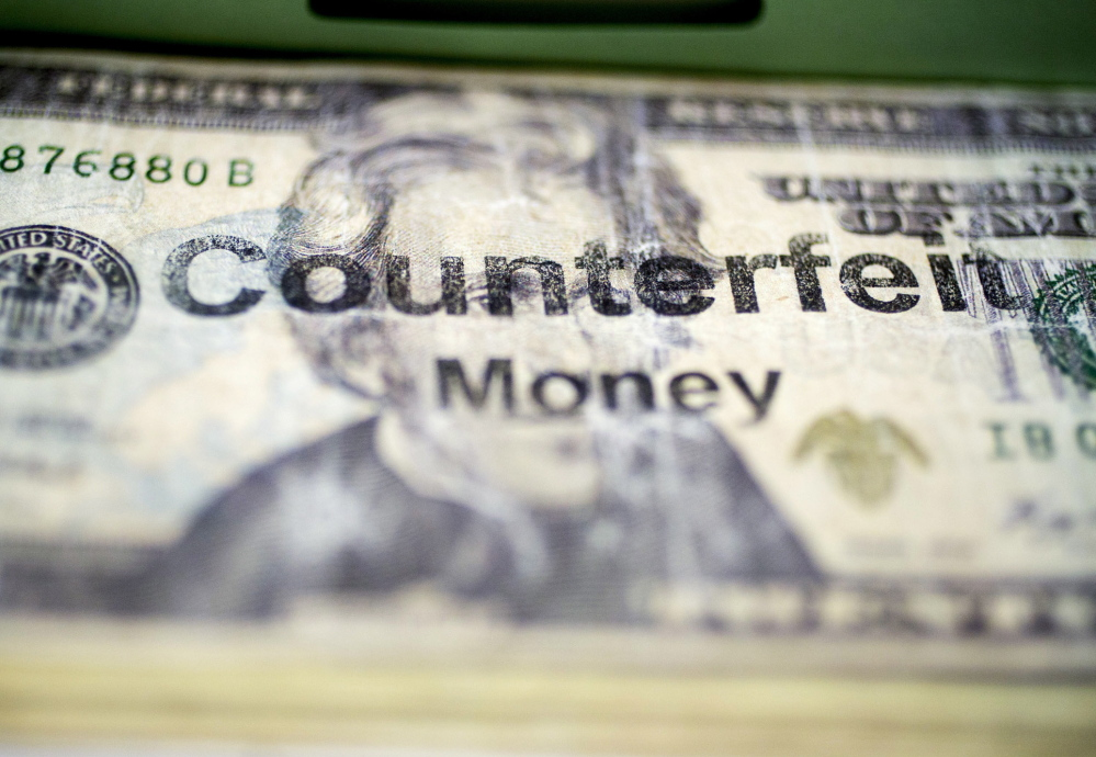 A counterfeit $20 bill sits in the counterfeit specimen vault at Secret Service headquarters in Washington, D.C.