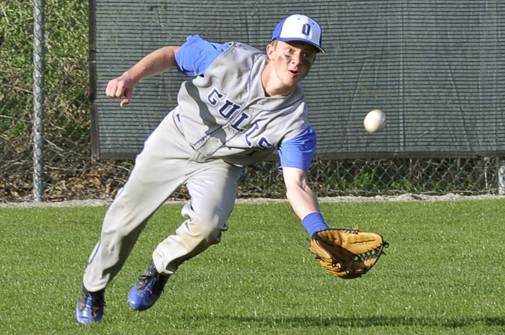 Tyler Scott of Old Orchard Beach heads to the ground to make a catch in center field Monday during Waynflete's 10-9 victory in a Western Maine Conference game at Portland.