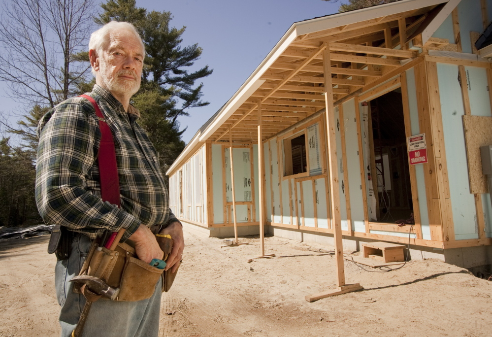 Robert Howe stands outside the energy-efficient, net-zero home he is having built in Brunswick. The home is designed to create as much energy as it consumes.