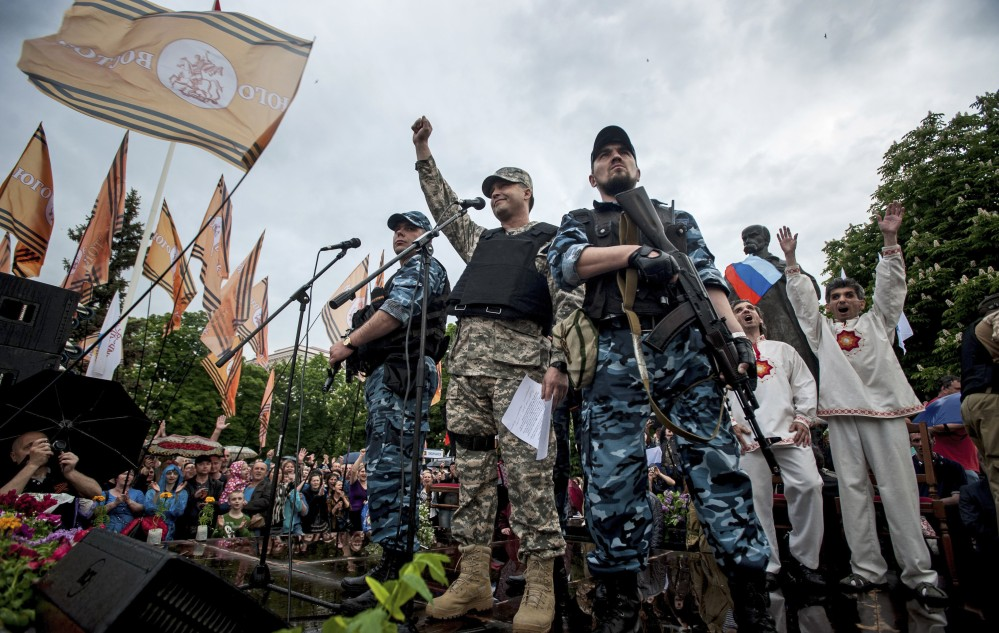 Pro-Russian gunmen and activists declare independence for the Luhansk region in eastern Ukraine on Monday. Leaders said they proposed to join with Donetsk to form a new republic.