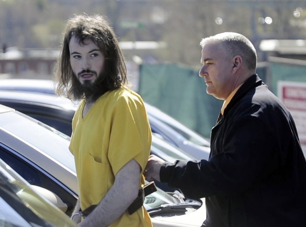 Leroy H. Smith III heads back to jail last week after a court appearance. He told police he had a flare-like warning system in woods near where he hoped to grow marijuana.