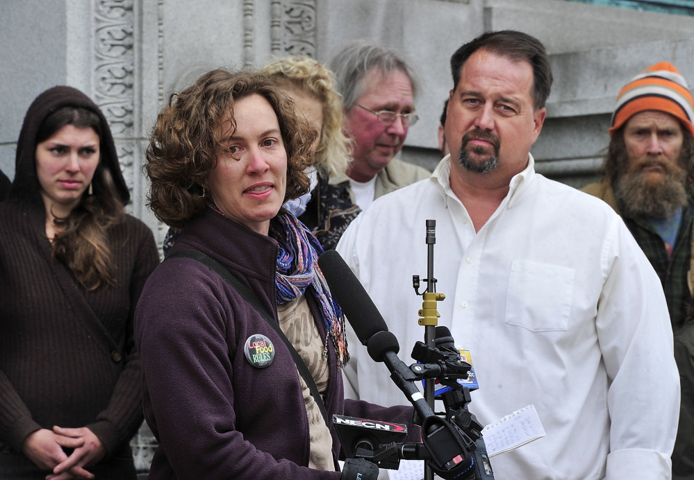 Heather Retberg, a farmer and founding member of Local Food RULES, addresses the media as she stands next to farmer Dan Brown during a rally prior to his case being heard by the Maine Supreme Judicial Court in Portland on Tuesday.