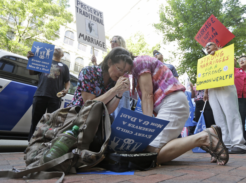 Members of the Family Foundation and supporters of traditional marriage pray outside the Federal Appeals Court in Richmond, Va., on Tuesday.