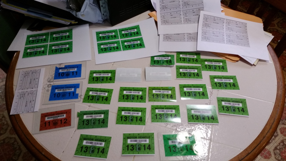 Police say they seized 37 counterfeit vehicle inspection stickers, proofs of the stickers, a computer and a printer at a Lewiston house. Fake stickers likely sold for $100 or more each.