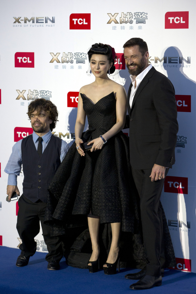 Hugh Jackman, right, and Chinese co-star Fan Bingbing pose at the opening of their film in Beijing on Tuesday.