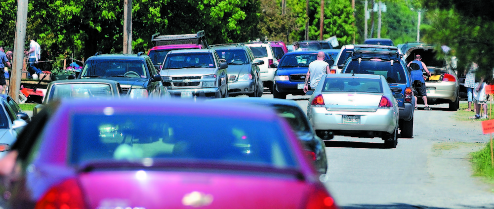 Traffic is at a near standstill at the annual 10-mile yard sale running from Cornville to Skowhegan in May 2012. Police say they will not hesitate to tow cars that are blocking roads during this year's sale this weekend.