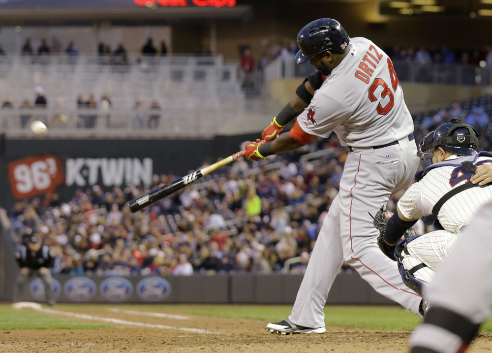 Boston Red Sox designated hitter David Ortiz hits a solo home run off Minnesota Twins relief pitcher Caleb Thielbar in the fifth inning in Minneapolis on Wednesday.