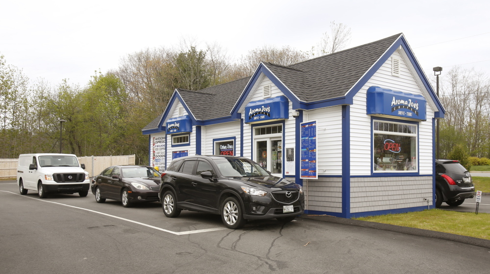 """Cars line up at the Aroma Joe's in Saco on Monday. """"We look for locations that have an easy-in, easy-out access and great exposure from the road,"""" co-owner Marty McKenna says."""
