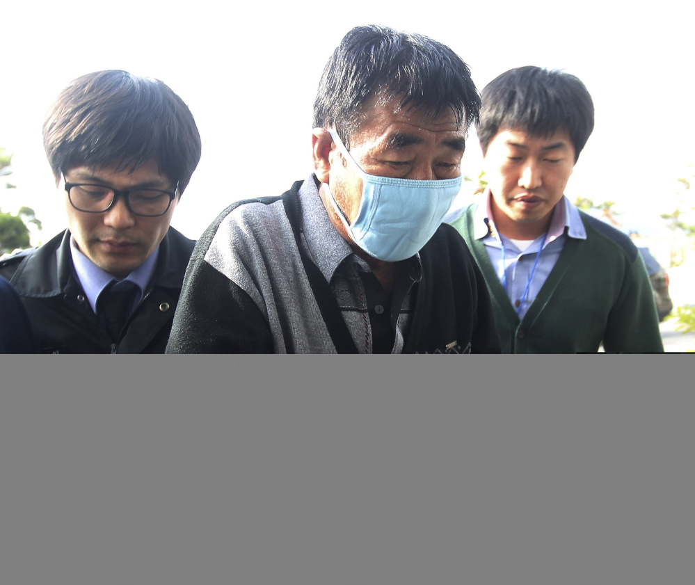 Lee Joon-seok, the captain of the sunken ferry Sewol, arrives at the headquarters of a joint investigation team of prosecutors and police in Mokpo, South Korea, in this April 19, 2014, photo.