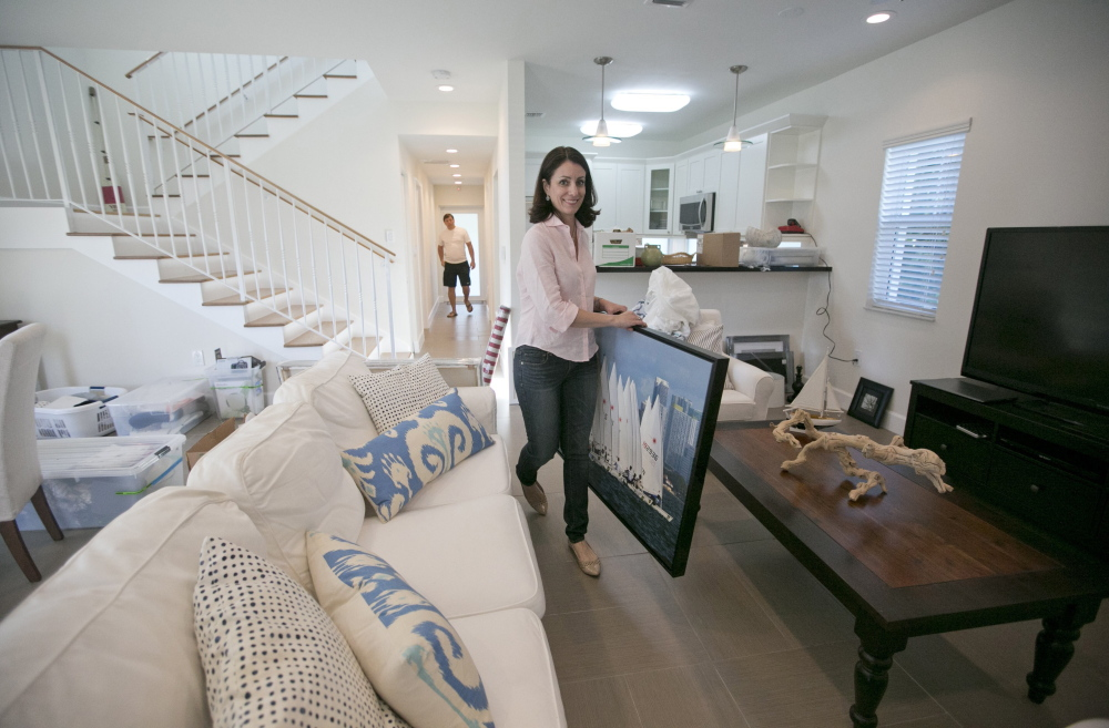 "Marisa Salas, owner of the home-staging company, Showhomes, decorates a home in Little Gables, Fla., for sale. ""We create the emotional aspect of a house,"" Salas says."