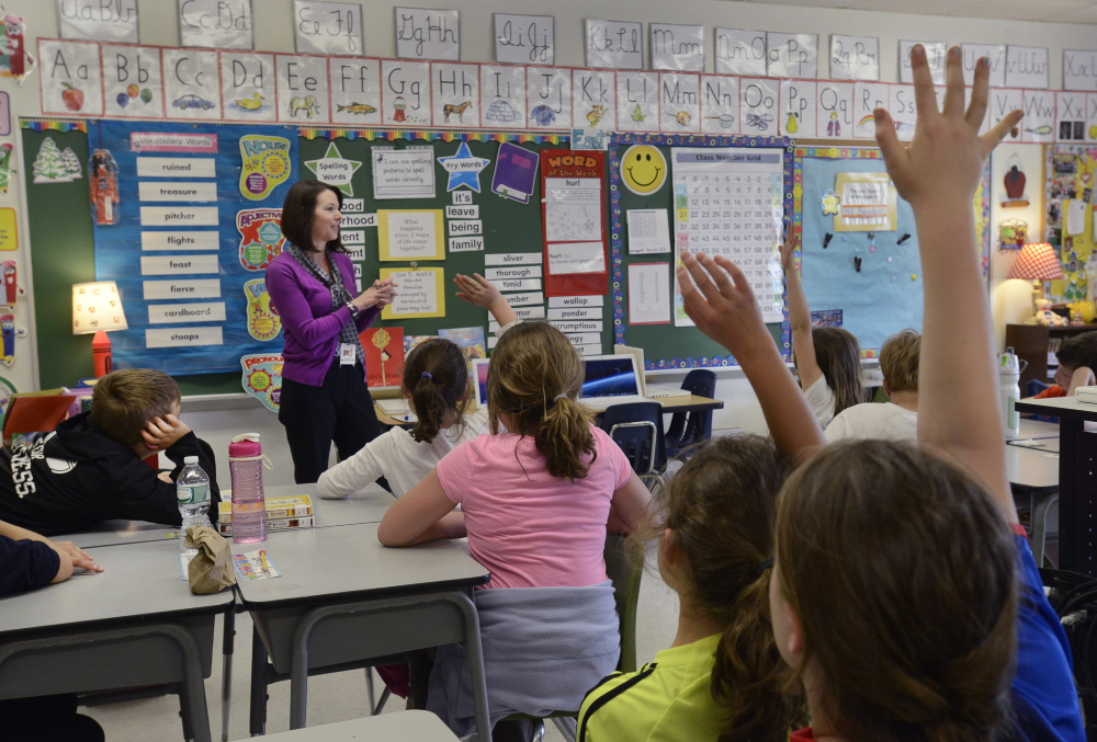 Tracy Burns teaches third grade at the Narragansett School in Gorham, which improved by two letter grades.