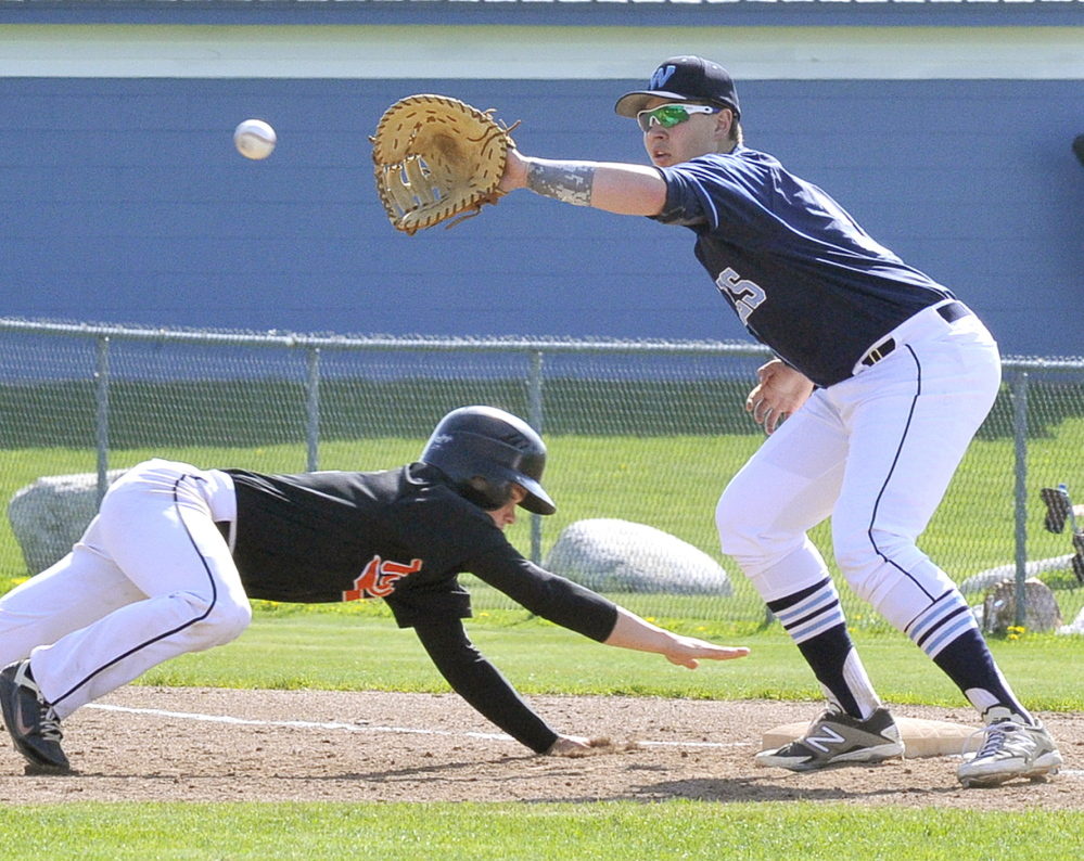Corey Creeger of Biddeford dives back as first baseman D.J. Henrikson of Westbrook collects the throw on a pickoff attempt Thursday during Biddeford's 7-1 victory. Creeger was the winning pitcher, allowing four hits and striking out seven.