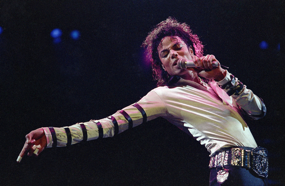 Michael Jackson performs during a 13-city U.S. tour in Kansas City, Mo. The owners of technology used to create holograms of deceased celebrities are trying to block Sunday's Billboard Music Awards from using their technology to generate a Jackson hologram during the show.