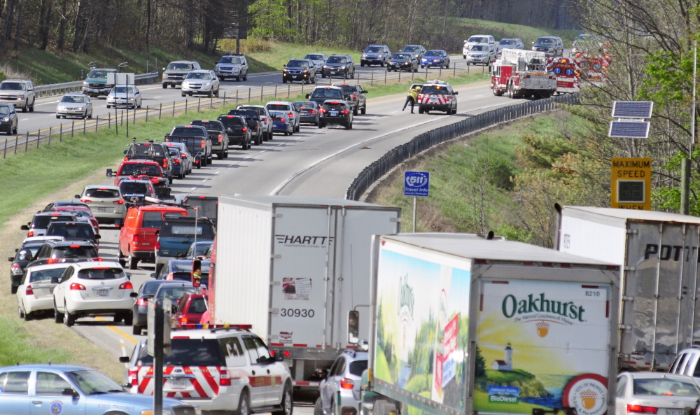 Traffic backs up northbound on Interstate 95 between exits 109 and 112 Friday as firefighters work to extinguish a brush fire.