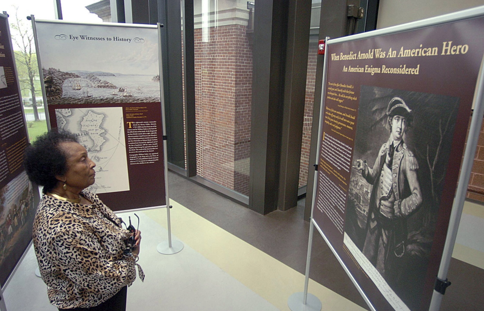 Lottie B. Scott, a member of the Norwich Historical Society, examines an exhibit on Revolutionary War Gen. Benedict Arnold at the Slater Memorial Museum in Norwich, Conn.