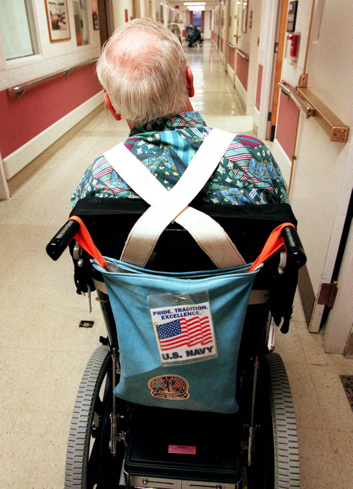 A veteran shows his pride by displaying a flag on his wheelchair. A reader says the average Maine nursing home resident is not a home care candidate.