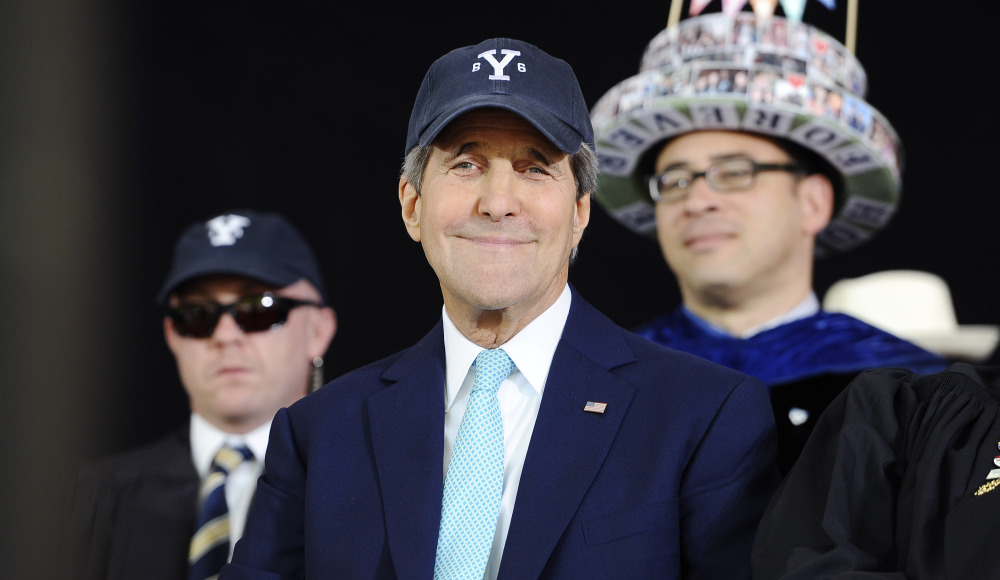 Secretary of State John Kerry smiles while watching Class Day Exercises at Yale University on Sunday.