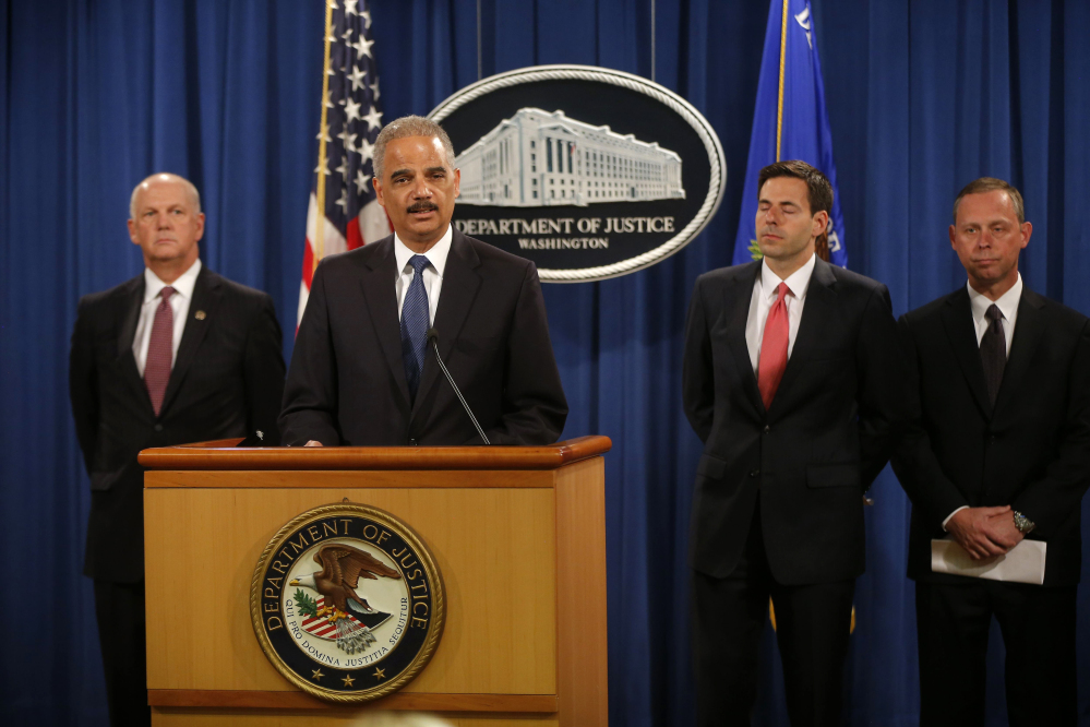 Attorney General Eric Holder announces Monday that a U.S. grand jury has charged five Chinese hackers with economic espionage and trade secret theft.