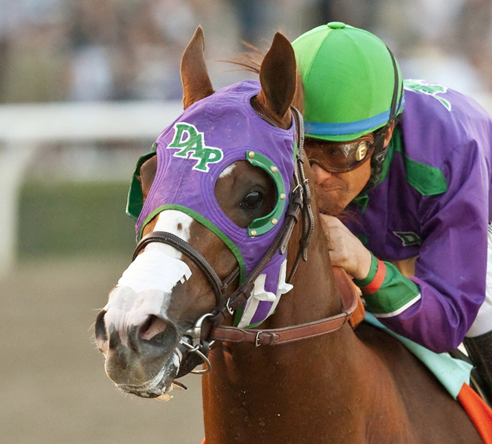 California Chrome, ridden by jockey Victor Espinoza, will be allowed to wear a nasal strip in the Belmont Stakes.