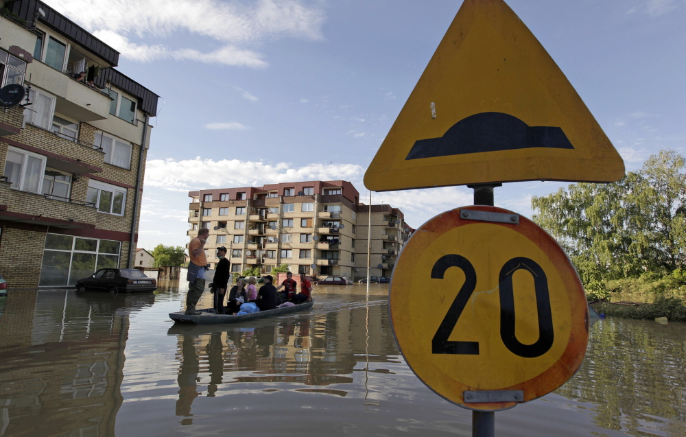 Residents are evacuated by boat in Bosanski Samac, a town in northeastern Bosnia on the banks of the Sava River.