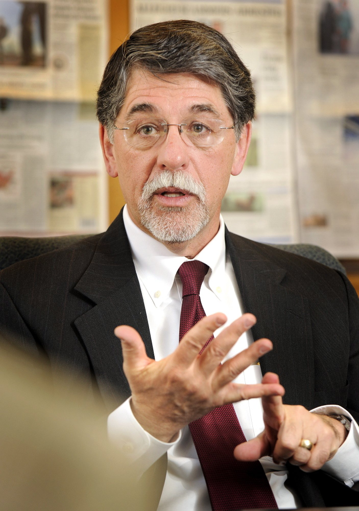 Richard Pattenaude, a former University of Maine System chancellor, now leads Ashford University in Iowa, which has reached a settlement with that state that includes changing its practices to recruit online students nationwide.