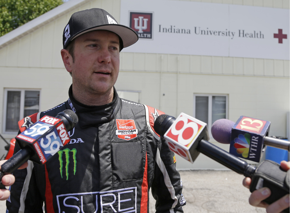 Kurt Busch is interviewed as he leaves the track medical center after he crashed in the second turn during practice for the Indianapolis 500 IndyCar auto race at the Indianapolis Motor Speedway on Monday. He was cleared to drive.