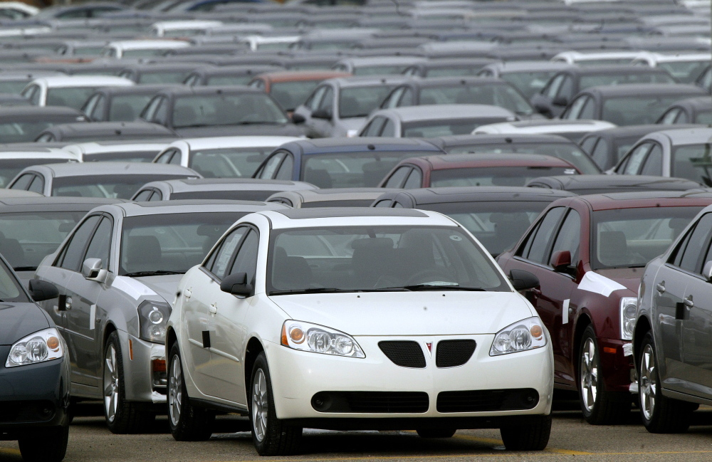 2006 Pontiac G6s are lined up outside the General Motors Orion Assembly plant in Orion Township, Michigan. General Motors is recalling 2.4 million vehicles in the U.S., including Pontiac G6s from the 2005-2008 model years.