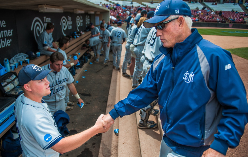 USM Head Coach Ed Flaherty congratulates pitcher Ryan Yates of Norway in last year's Division III championships. Flaherty's teams won national titles in 1991 and 1997.