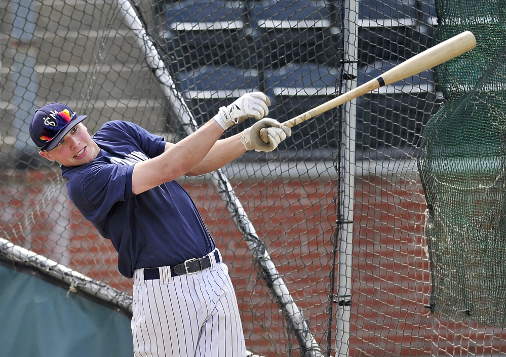 Sam Dexter takes batting practice before heading to the NCAA Division III baseball championships in Appleton, Wisconsin.