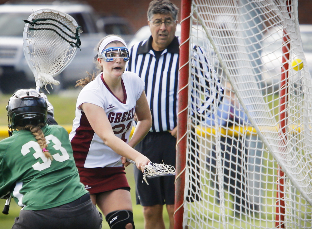 Gabby Bouchard of Greely gets the ball past Waynflete goaltender Charlotte Majercik to score a first-half goal. Waynflete scored twice near the end of the half to make it 4-4 at the break.