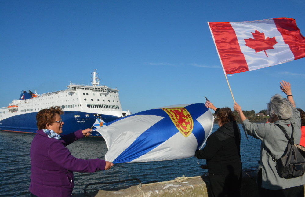 Proud Nova Scotians Louise Zinck, Doreen Rogers and Colette Randell welcome the Nova Star's arrival on its maiden voyage from Portland.