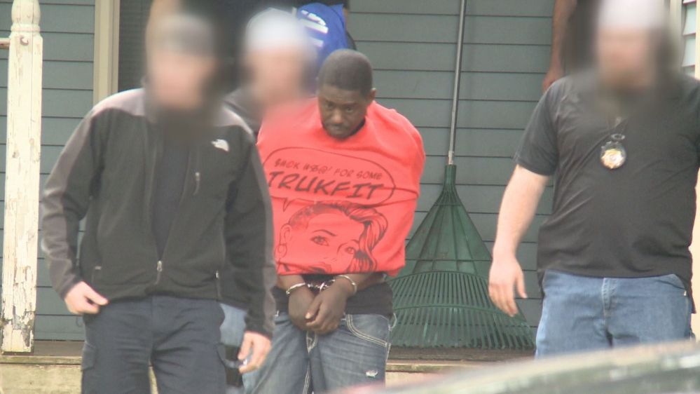 Jacques Victor is arrested at 21 Harris St. in Auburn on Thursday.