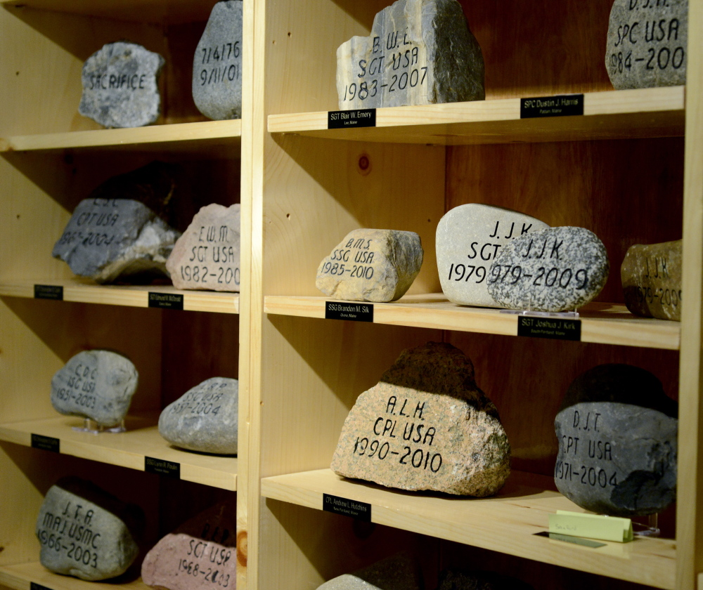 Memorial stones are on display in the Military Entrance Processing Station on Congress Street in Portland.