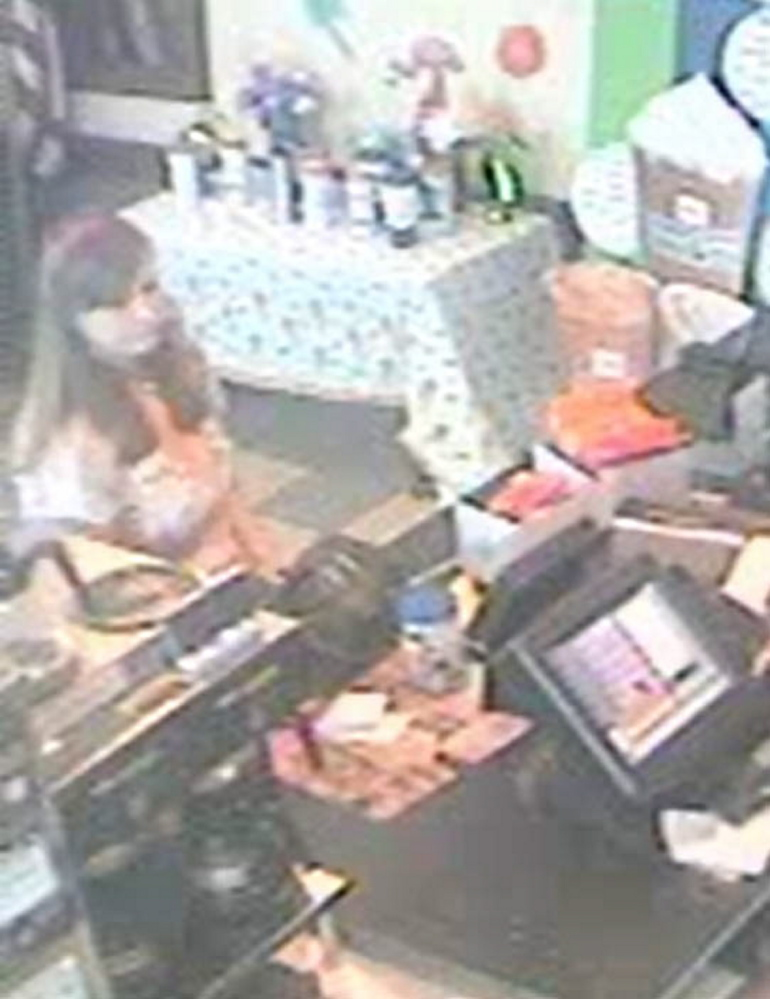 Westbrook police are seeking the public's help in identifying a woman who is believed to have taken a donation jar from a Dunkin' Donuts.